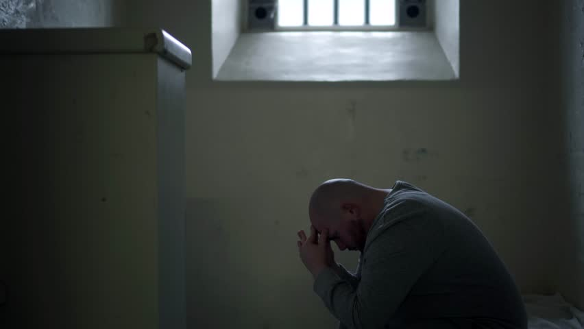 Prisoner Alone In Cell, Cinematic Incarceration In Modern Prison, 4K Inmate Locked Up By Guard. Part Of A Collection With A Variety Of Camera Angles, With And Without Inmates, Guards.