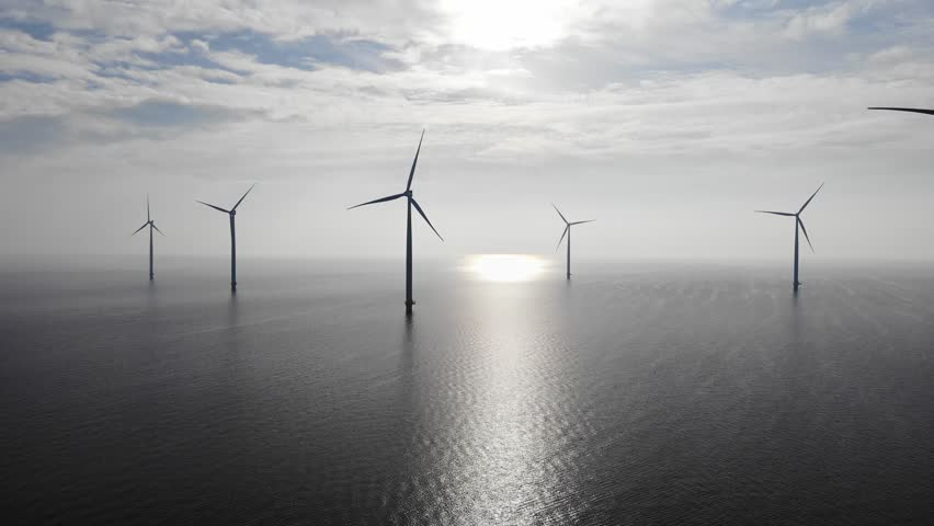 Offshore Windmill farm in the ocean  Westermeerwind park , windmills isolated at sea on a beautiful bright day Netherlands Flevoland Noordoostpolder, Drone view from above out the sky bird eye view Royalty-Free Stock Footage #1007806810