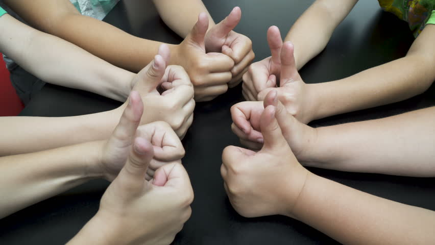 Five Children giving a thumbs up to the positive signal. close up. 10  thumbs-up #1007809756