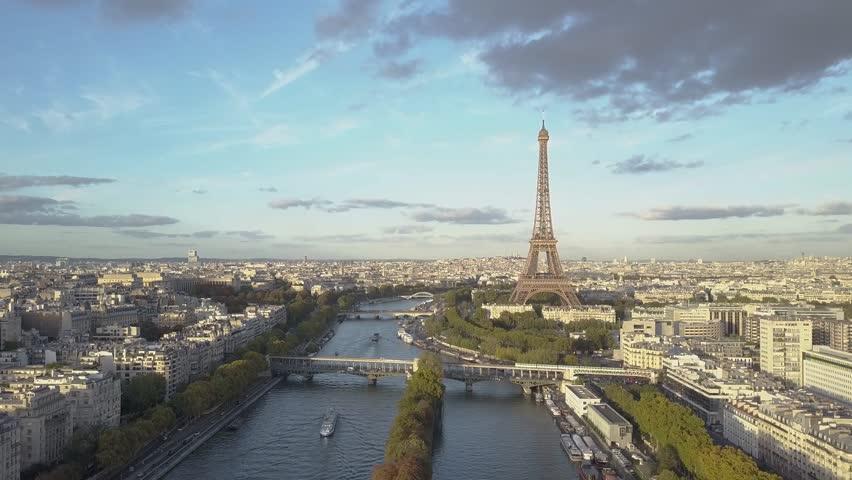 Aerial of Paris Eiffel Tower and Seine River. Train crossing the bridge | Shutterstock HD Video #1007822512