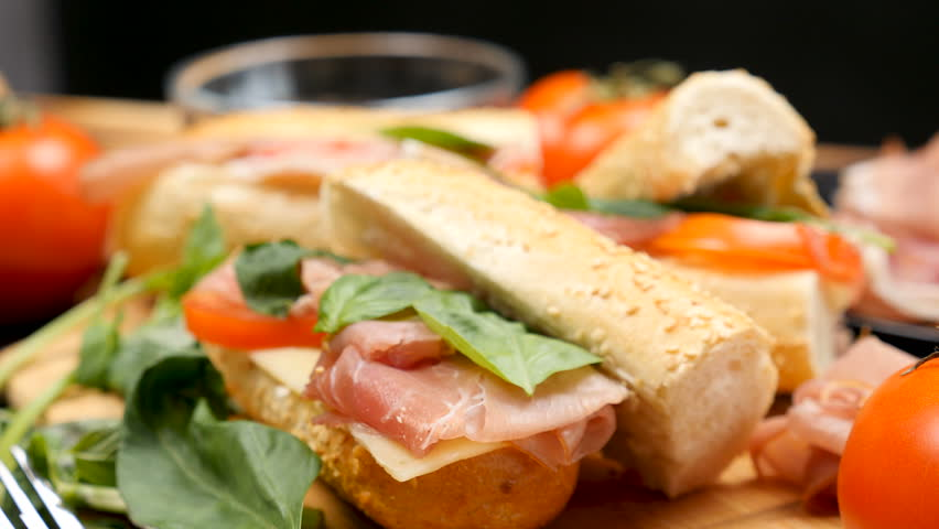 Parallax dolly shot of healthy delicous sandwich made of prosciutto, cheese and tomatoes at the kitchen | Shutterstock HD Video #1007845117