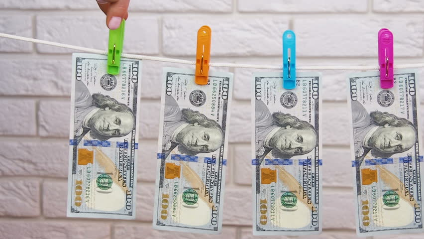Laundering of money. Money on the rope. | Shutterstock HD Video #1007865613