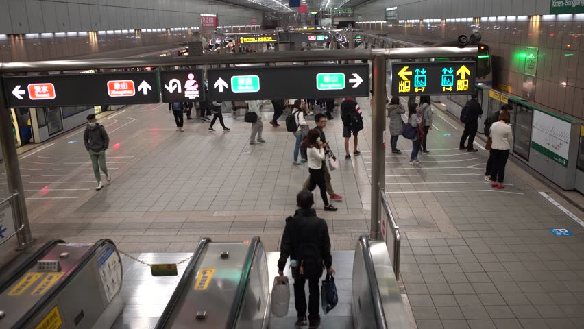 Taipei, Taiwan-16 February, 2017: 4K Asian people in subway entrance escalator leading into train station in Taipei city. Modern metro system in Taiwan.-Dan | Shutterstock HD Video #1007881918