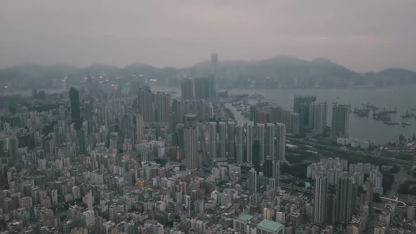 Flying over Hong Kong Kowloon City in a foggy day   Shutterstock HD Video #1007912101