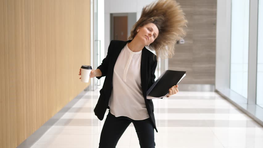 Happy Successful Businesswoman Dancing In Office Hall #1007924938