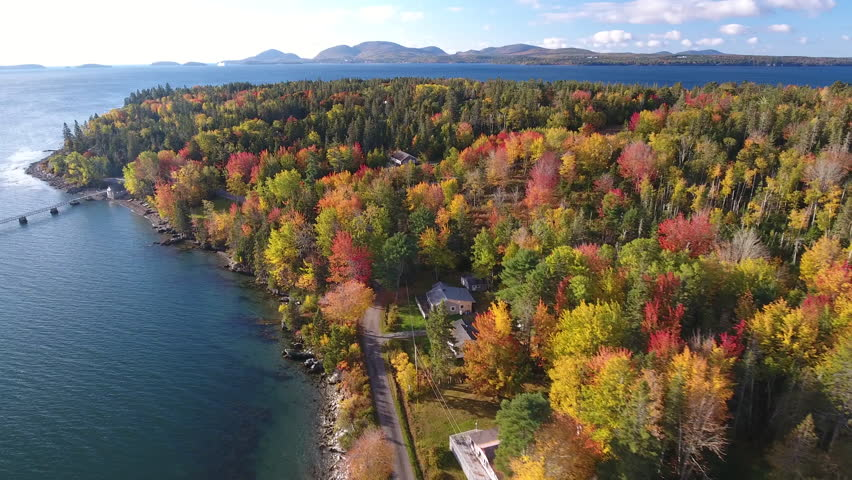 A breathtaking aerial view of Hancock, Maine looking across Mt Desert Narrows to Acadia National Park with the Fall colors in their peak. USA