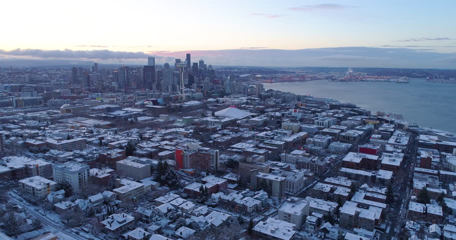 Seattle Washington Cityscape Aerial Fly Away From Downtown Neighborhood Snowy Cold Winter Landscape