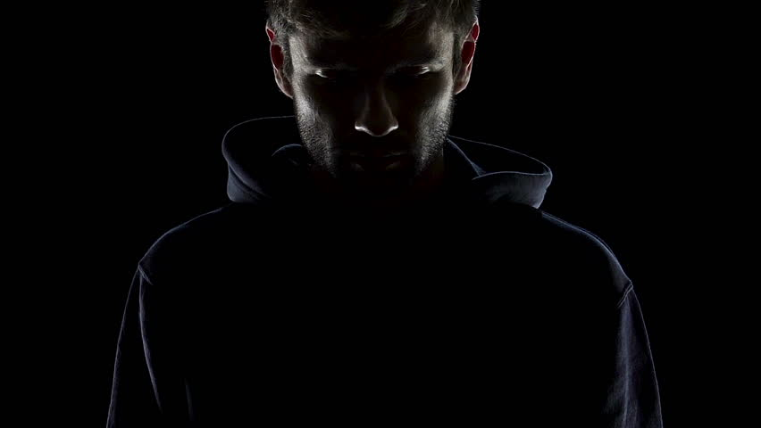 Bearded man putting on hood, hiding from people, anonymous dark silhouette | Shutterstock HD Video #1007973856