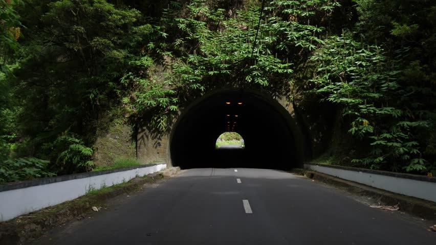 drive through a mountain tunnel pov azores 4k