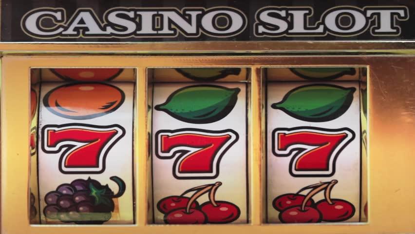 Retro slot machine spinning to win 777 , BAR BAR BAR .