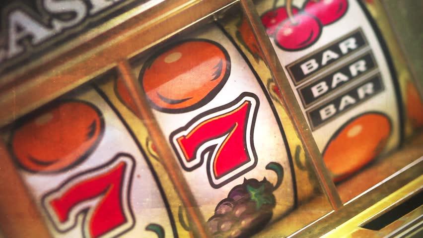 Retro slot machine spinning to 777,and BAR BAR BAR .