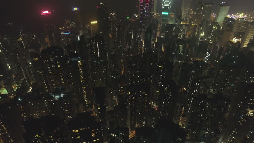 Hong Kong City Residential Tall Buildings at Night. Aerial Vertical Top-Down View. Drone is Flying Forward. Establishing Shot.