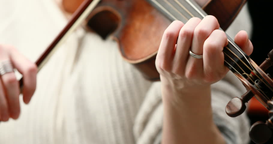 classical musician playing baroque violin on a black background - hands closeup live action concept