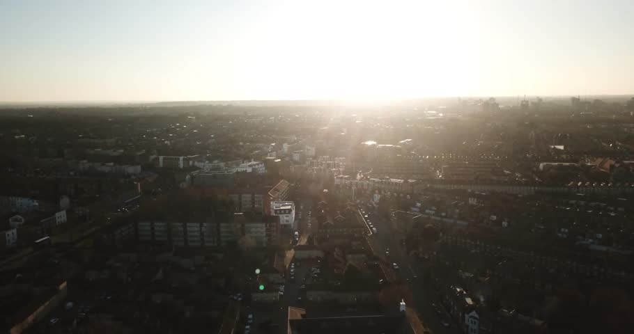 Sweeping drone footage of South London, England, (Battersea) during a bright sunset. | Shutterstock HD Video #1008035137