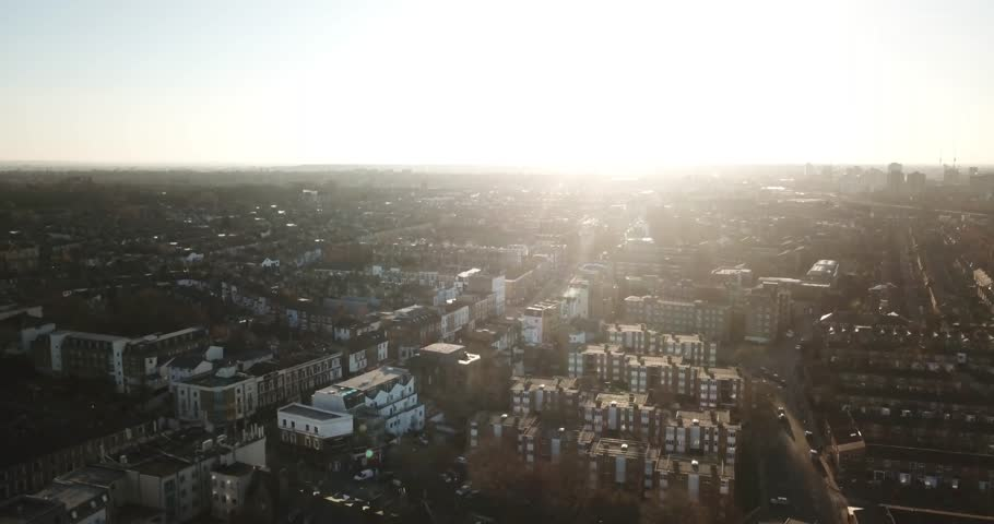 Sweeping drone footage of South London, England, (Battersea) during a bright sunset. | Shutterstock HD Video #1008035146