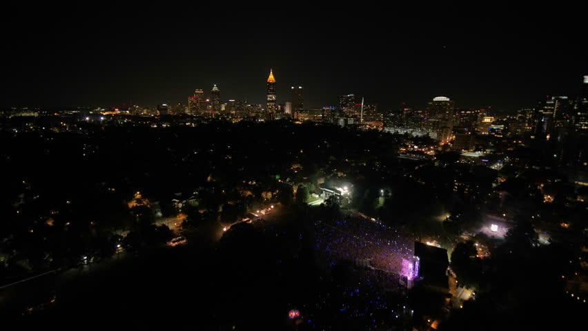 Atlanta Aerial v313 Flying over music festival in park cityscape night 9/17