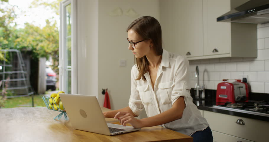 4K Professional woman working from home & having heated discussion over the phone | Shutterstock HD Video #1008045919