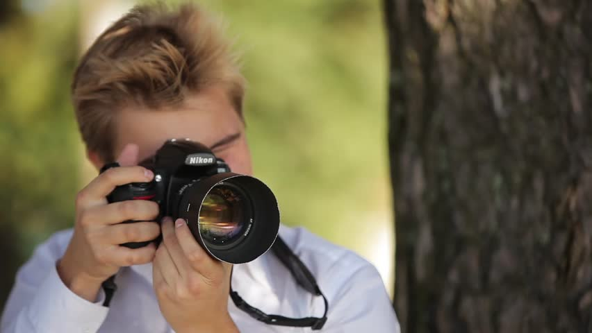 SAINT-PETERSBURG, RUSSIA - SEPTEMBER 19, 2014 Photographer taking photo outdoors #1008049870