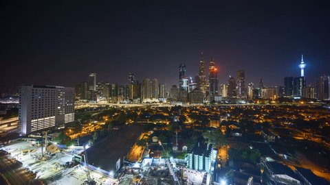 4k time lapse from night to day morning scene at Kuala Lumpur city skyscrapers.