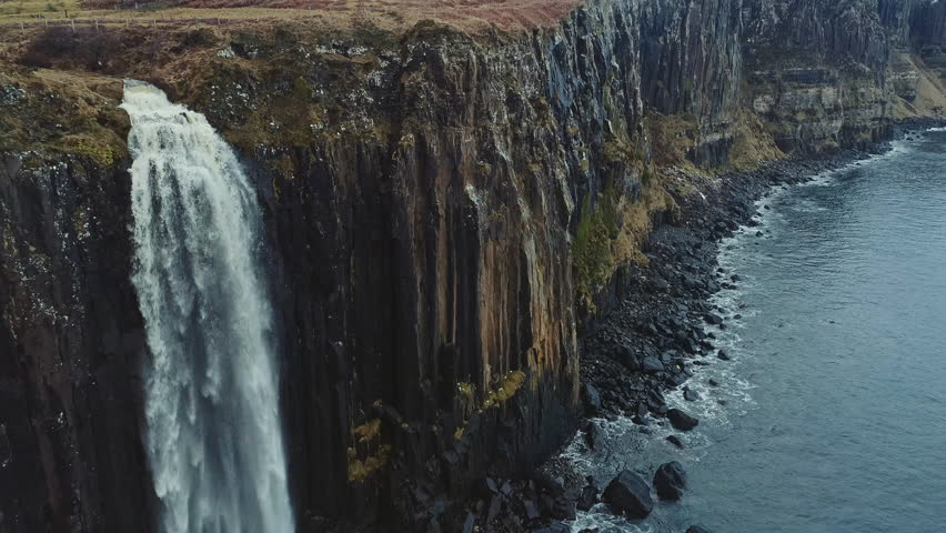 Aerial reveal of Kilt Rock and Mealt Falls from the Isle of Skye in Scotland, UK | Shutterstock HD Video #1008063952