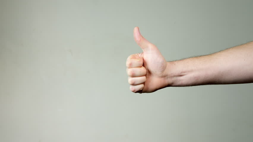 4K Strong Hand giving thumbs up, white male hand gesture, Well done sign, isolated on background