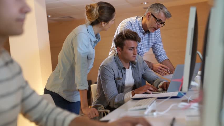 Students attending web design class with teacher | Shutterstock HD Video #1008102025