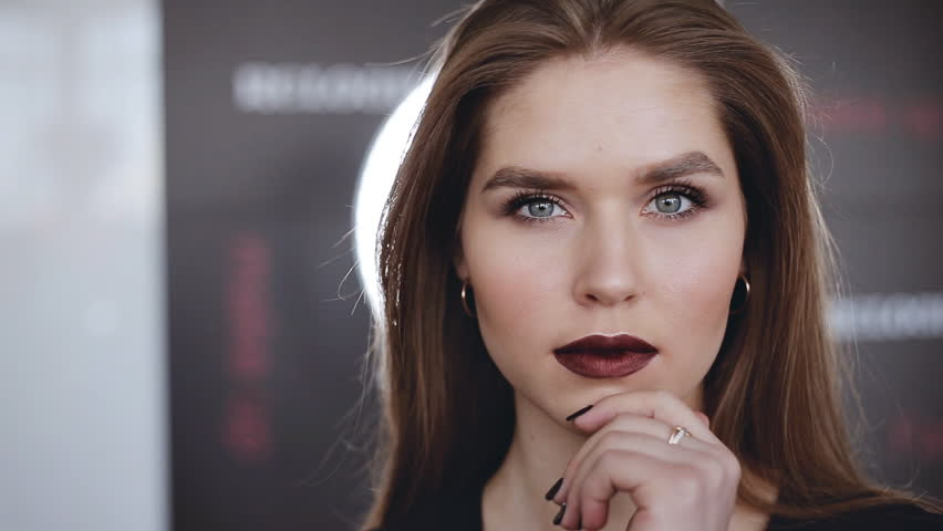 Beauty girl face close up. Trend lips makeup with bright dark color lipstick | Shutterstock HD Video #1008113587