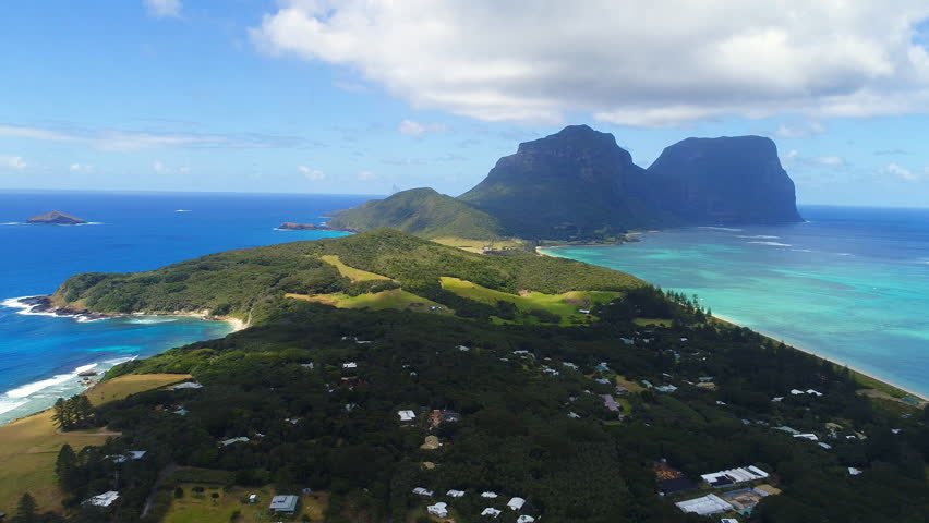 Aerial view of Lord Howe Island (World Heritage-listed paradise), turquoise blue lagoon and Mount Gower on background - New South Wales - Tasman Sea - Australia from above, 4k UHD | Shutterstock HD Video #1008115315