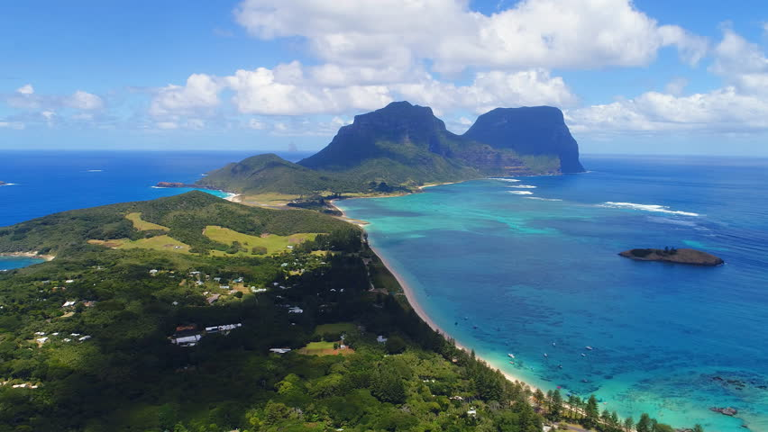 Aerial view of Lord Howe Island (World Heritage-listed paradise), turquoise blue lagoon and Mount Gower on background - New South Wales - Tasman Sea - Australia from above, 4k UHD | Shutterstock HD Video #1008115777