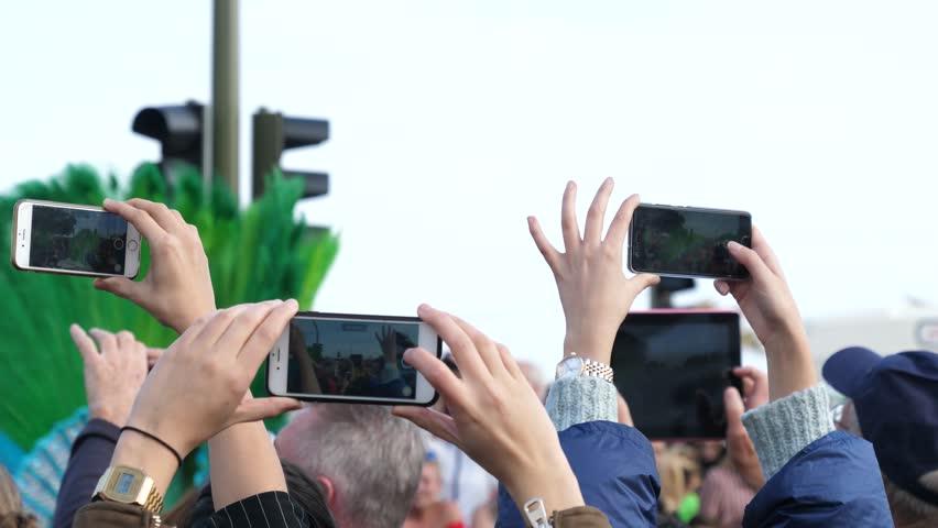 SANTA CRUZ DE TENERIFE - FEB 13, 2018: Spectators in crowd take mobile phone video of public carnival festival procession show   Shutterstock HD Video #1008130270