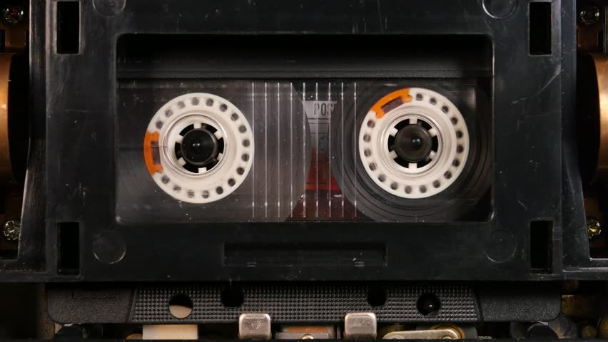 Old cassette player playing music retro style