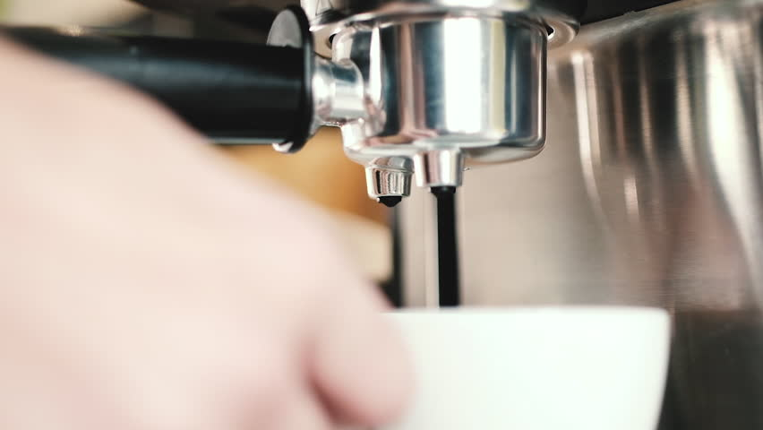 Slow motion camera on dolly / track. Making coffee at home or in a small coffee shop. Close-up, counter-light, low depth - film depth of field. | Shutterstock HD Video #1008137680