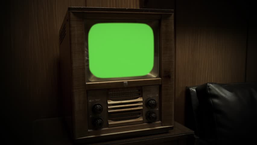 """Old Wooden TV with Green Screen. Retro Tone. Zoom In. You can Replace Green Screen with the Footage or Picture you Want with """"Keying"""" effect in After Effects (check out tutorials on YouTube)."""