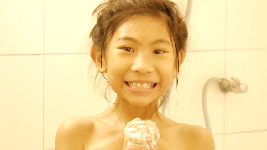 Happy girl plays bubbles while taking a shower.   Shutterstock HD Video #1008147010