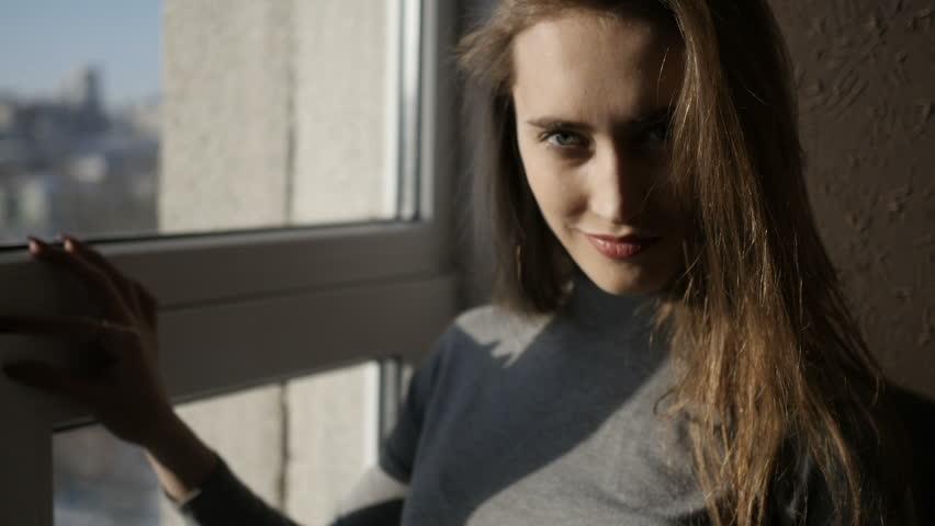 Girl is standing near the window | Shutterstock HD Video #1008147493