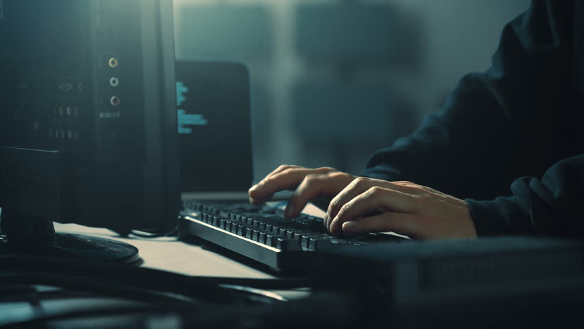 Computer hacker typing code on keyboard late night working.  | Shutterstock HD Video #1008169021