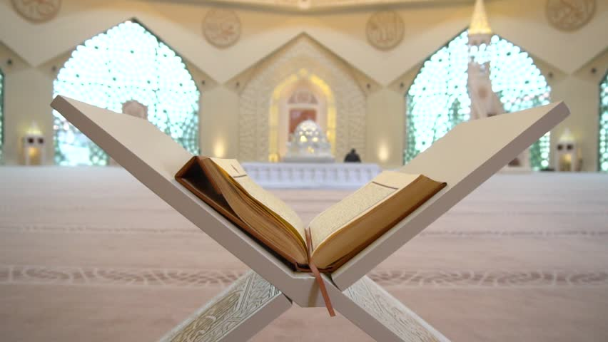 A Muslim man reads a koran or quran in an Islamic mosque | Shutterstock HD Video #1008172069