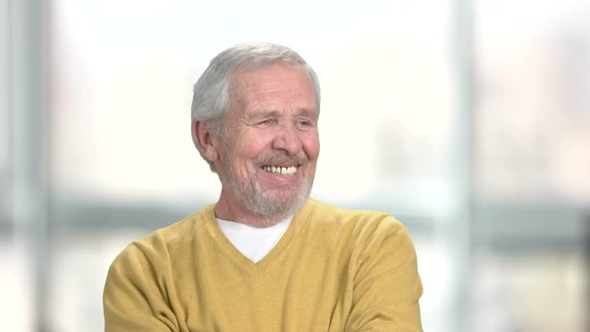 Cheerful senior man, blurred background. Smiling bearded mature man. Human positive emotions. | Shutterstock HD Video #1008176962
