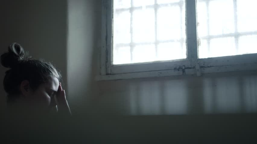 Female Prisoner Behind Bars, Incarceration In Modern Prison, 4K Inmate Locked Up.