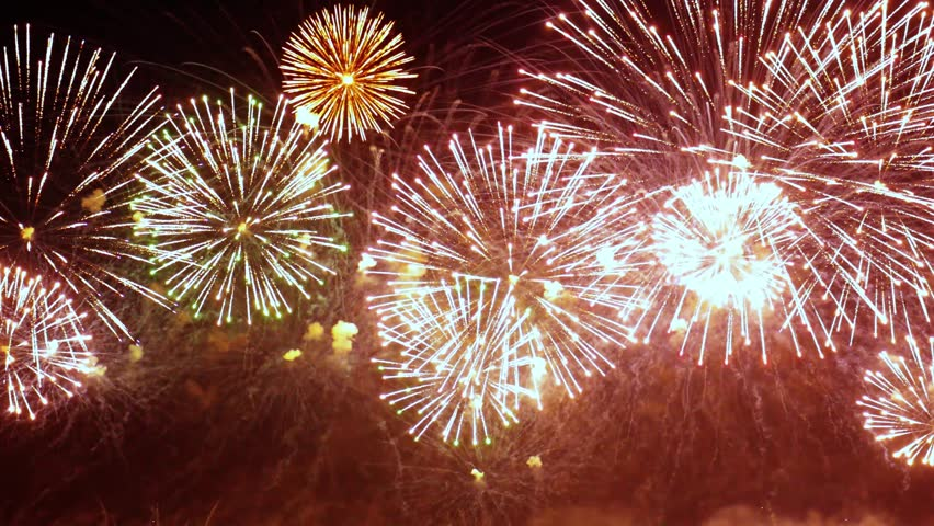 Colorful fireworks exploding in the night sky. Celebrations and events in bright colors.   Shutterstock HD Video #1008192424