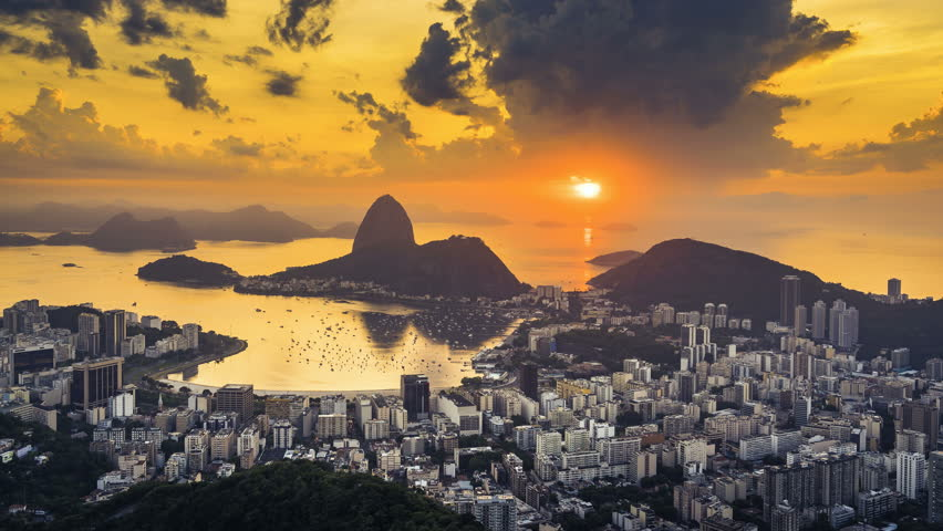 Sunrise over Sugarloaf Mountain in  Rio de Janeiro, Brazil. High angle view with reflection of the rising sun on water | Shutterstock HD Video #1008196519