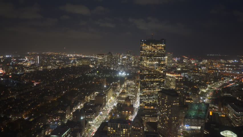 A night panning shot of the financial district of boston from the observation deck of skywalk in boston, massachusetts | Shutterstock HD Video #1008197185