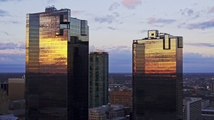 Fort Worth, Texas / USA - March 08, 2017 4K aerial footage of the sunrise reflecting on the buildings and skyline.