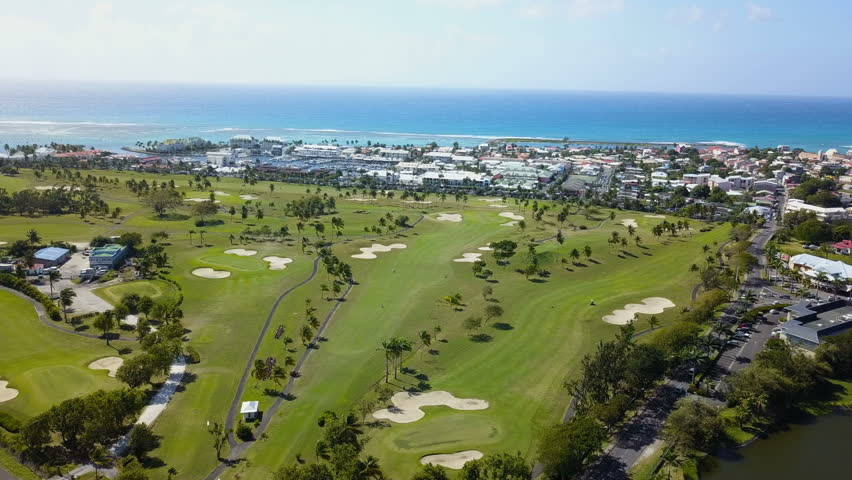 Golf course in aerial view with villas   Shutterstock HD Video #1008211660