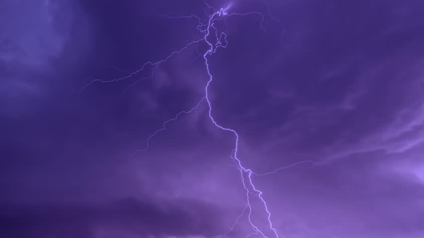 Realistic lightning strikes.Thunderstorm with flashing lightning. Lightning flashes over a city during a strong monsoon. Electric discharges flashing, hitting earth during heavy night storm. FHD.