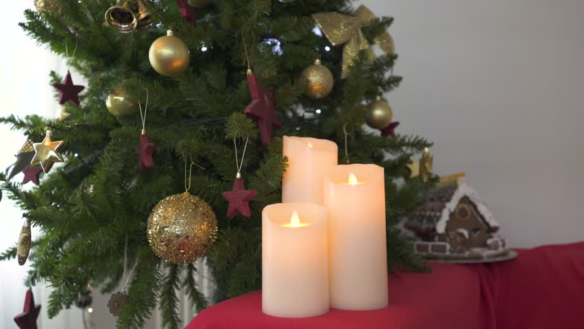 Beautiful fake candles near the Christmas tree | Shutterstock HD Video #1008216511