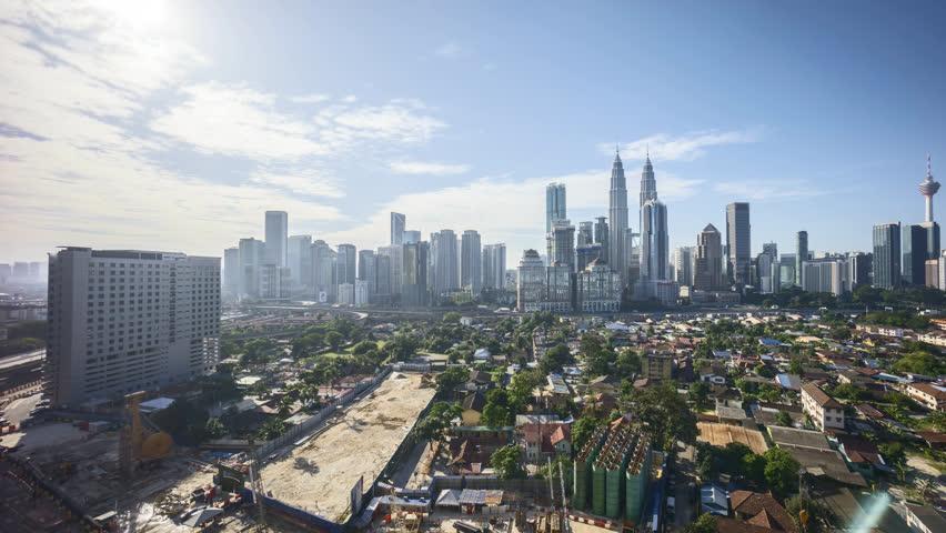 Cloudscape view of Kuala Lumpur city skyline. 4k UHD time lapse. Pan right | Shutterstock HD Video #1008261364