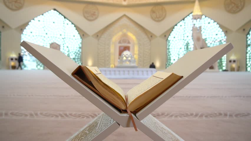 A man is reading Quran or koran on the reading desk in a mosque. | Shutterstock HD Video #1008270088