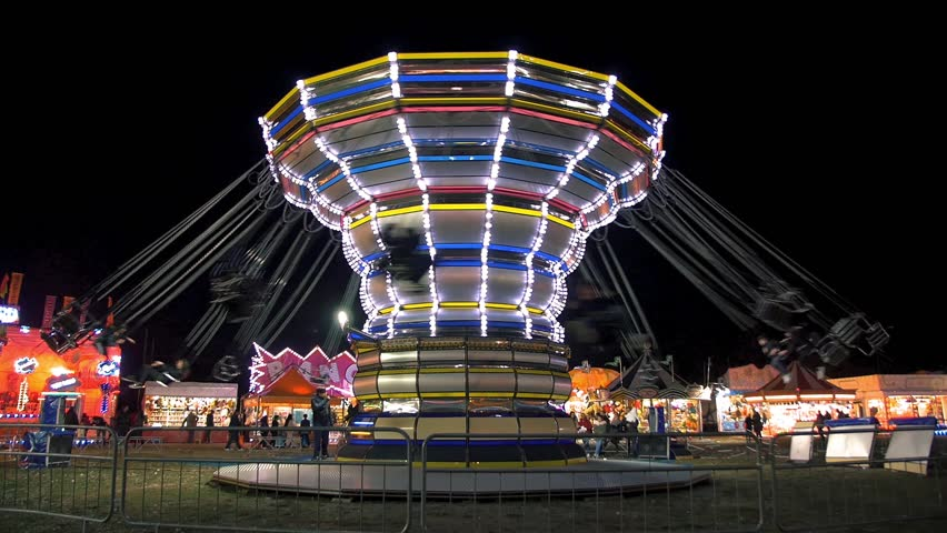 Chairoplane carousel in night amusement park Royalty-Free Stock Footage #1008292732