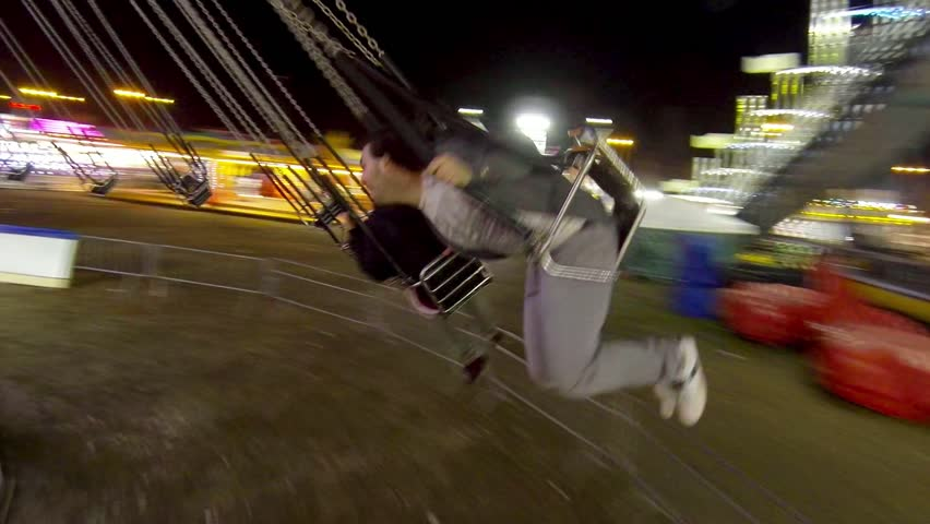 Friends riding the chairoplane carousel Royalty-Free Stock Footage #1008292738